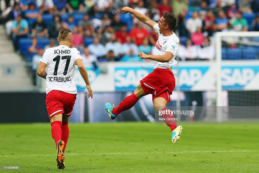 Oliver Sorg (R) of Freiburg celebrates his team's first goal with team mates Jonathan Schmid during the Bundesliga match between 1899 Hoffenheim and SC Freiburg at Wirsol Rhein-Neckar-Arena on August 24, 2013 in Sinsheim, Germany.