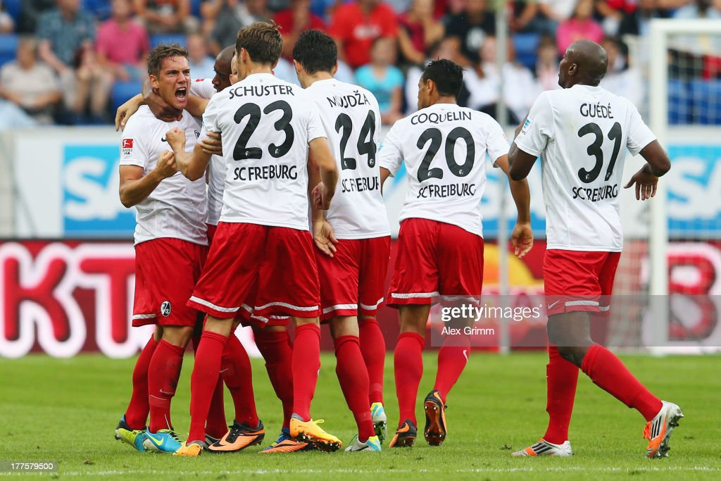 Oliver Sorg (L) of Freiburg celebrates his team's first goal with team mates during the Bundesliga match between 1899 Hoffenheim and SC Freiburg at Wirsol Rhein-Neckar-Arena on August 24, 2013 in Sinsheim, Germany.