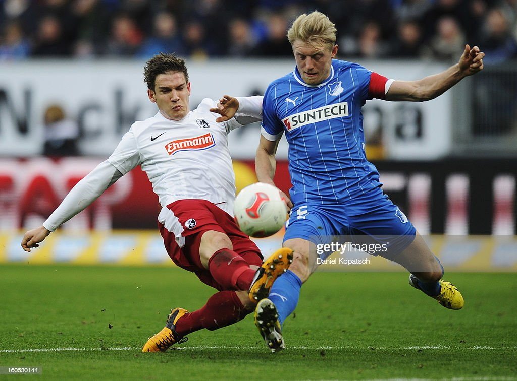 Oliver Sorg of Freiburg (L) is challenged by <a gi-track='captionPersonalityLinkClicked' href=/galleries/search?phrase=Andreas+Beck&family=editorial&specificpeople=635198 ng-click='$event.stopPropagation()'>Andreas Beck</a> of Hoffenheim during the Bundesliga match between TSG 1899 Hoffenheim and Sc Freiburg at Rhein-Neckar-Arena on February 2, 2013 in Sinsheim, Germany.