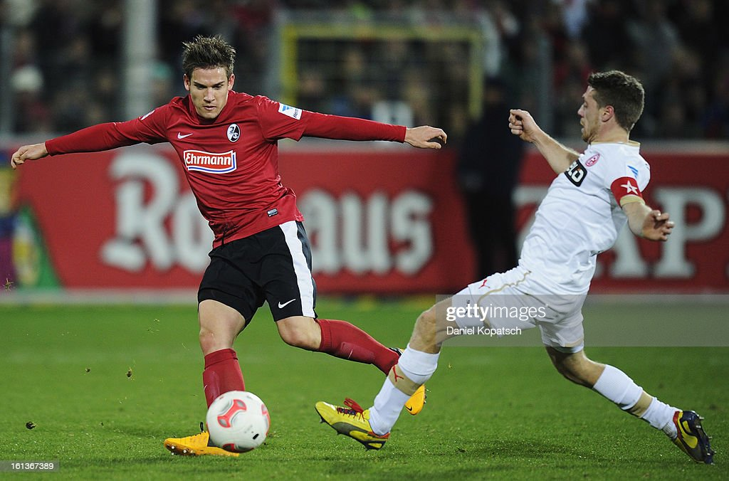 Oliver Sorg of Freiburg (L) is challenged by <a gi-track='captionPersonalityLinkClicked' href=/galleries/search?phrase=Andreas+Lambertz&family=editorial&specificpeople=2505535 ng-click='$event.stopPropagation()'>Andreas Lambertz</a> of Duesseldorf during the Bundesliga match between SC Freiburg and Fortuna Duesseldorf 1895 at MAGE SOLAR Stadium on February 10, 2013 in Freiburg im Breisgau, Germany.