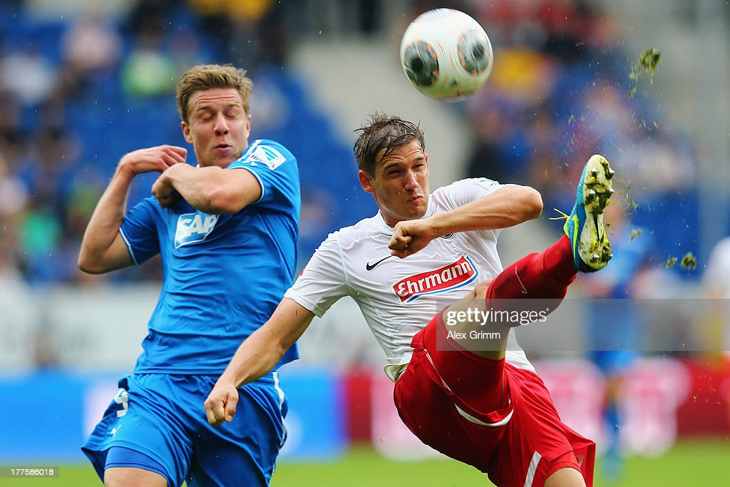 Oliver Sorg (R) of Freiburg is challenged by Sven Schipplock of Hoffenheim during the Bundesliga match between 1899 Hoffenheim and SC Freiburg at Wirsol Rhein-Neckar-Arena on August 24, 2013 in Sinsheim, Germany.