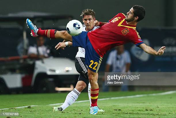 Oliver Sorg of Germany is challenged by Isco of Spain during the UEFA European U21 Champiosnship Group B match between Germany and Spain at Netanya...