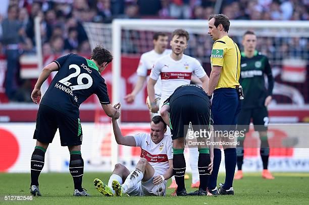 Oliver Sorg of Hannover 96 gives a helping hand to Kevin Grosskreutz of VfB Suttgart during the Bundesliga match between VfB Stuttgart and Hannover...