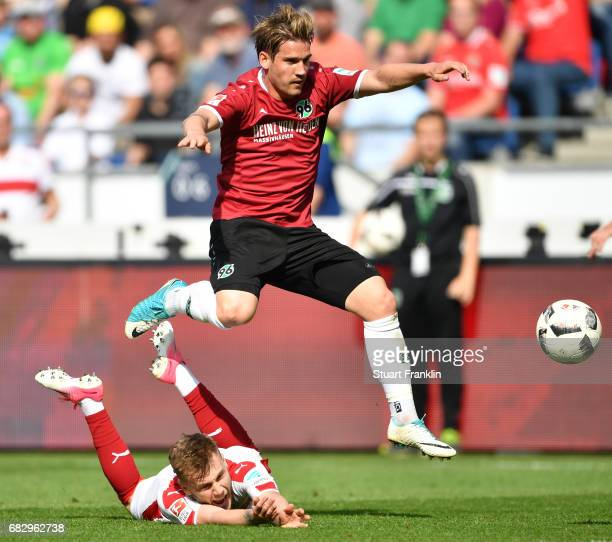 Oliver Sorg of Hannover is challenged by Alexandru Iulian Maxim of Stuttgart during the Second Bundesliga match between Hannover 96 and VfB Stuttgart...