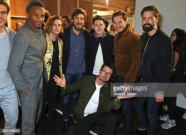 Oliver Spencer poses with Eric Underwood Dougie Poynter Robert Konjic Niall Horan Paul Sculfor and Jack Guinness backstage at the Oliver Spencer AW17...