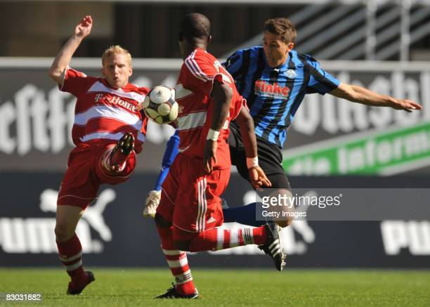 Oliver Stierle and Christian Saba of Bayern II and Jens Wemmer of Paderbornin fight for the ball during the 3 Bundesliga match between SC Paderborn...