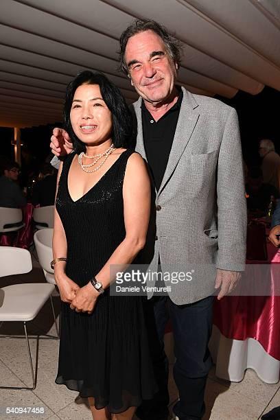 Oliver Stone and Sunjung Jung attend Baume Mercier 62 Taormina Film Fest Gala Dinner on June 17 2016 in Taormina Italy