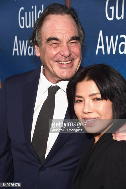Oliver Stone and Sunjung Jung attend the 2017 Writers Guild Awards LA Ceremony at The Beverly Hilton Hotel on February 19 2017 in Beverly Hills...