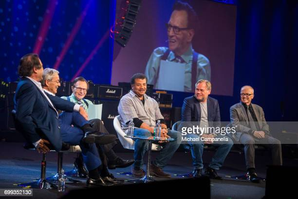Oliver Stone Chris Pissarides Larry King Neil deGrasse Tyson Eugene Kaspersky and Finn Kydland participates in a roundtable discussion during the...