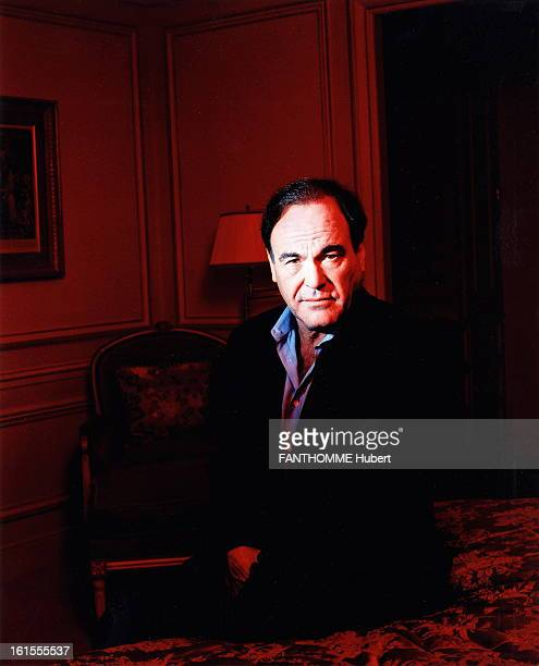 Oliver Stone In Paris Appointment with Oliver STONE in PARIS for the release of his new film 'Alexander' sitting on the bed of a hotel room bathed in...
