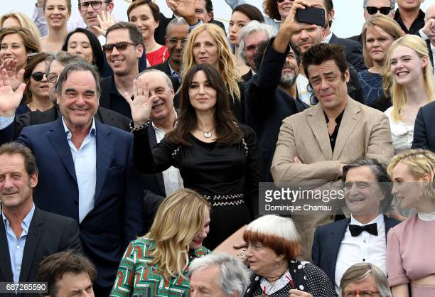 Oliver Stone Monica Bellucci and Benicio del Toro attends the 70th Anniversary photocall during the 70th annual Cannes Film Festival at Palais des...