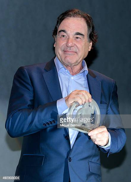 Oliver Stone poses with his Grand Honorary Award at the 48th Sitges Film Festival on October 11 2015 in Sitges Spain