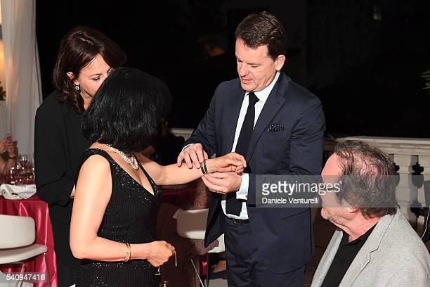 Oliver Stone Sunjung Jung and Alain Zimmermann attend Baume Mercier 62 Taormina Film Fest Gala Dinner on June 17 2016 in Taormina Italy
