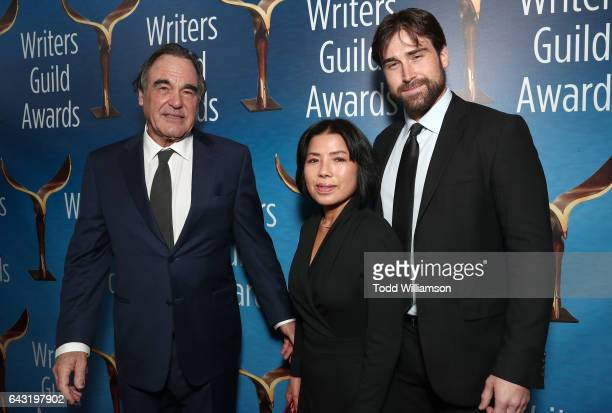 Oliver Stone Sunjung Jung and Sean Stone attend the 2017 Writers Guild Awards LA Ceremony at The Beverly Hilton Hotel on February 19 2017 in Beverly...
