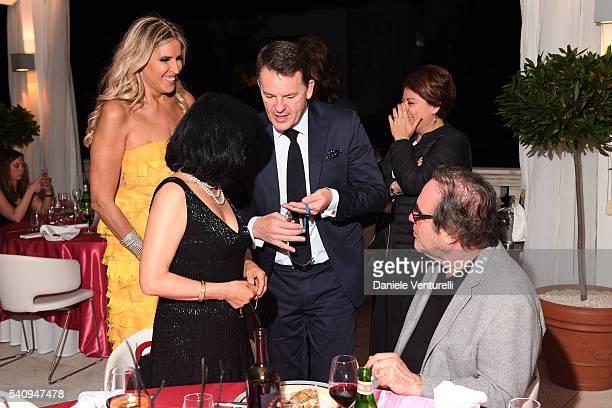 Oliver Stone Sunjung Jung Tiziana Rocca and Alain Zimmermann attend Baume Mercier 62 Taormina Film Fest Gala Dinner on June 17 2016 in Taormina Italy