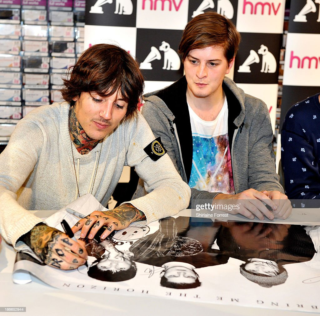 Oliver Sykes and Matt Kean of Bring Me The Horizon meet fans and sign copies of a new HMV Exclusive T-Shirt at HMV Birmingham Bullring on November 2, 2013 in Birmingham, England.