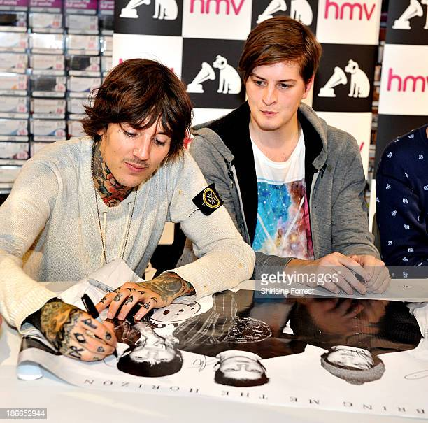 Oliver Sykes and Matt Kean of Bring Me The Horizon meet fans and sign copies of a new HMV Exclusive TShirt at HMV Birmingham Bullring on November 2...