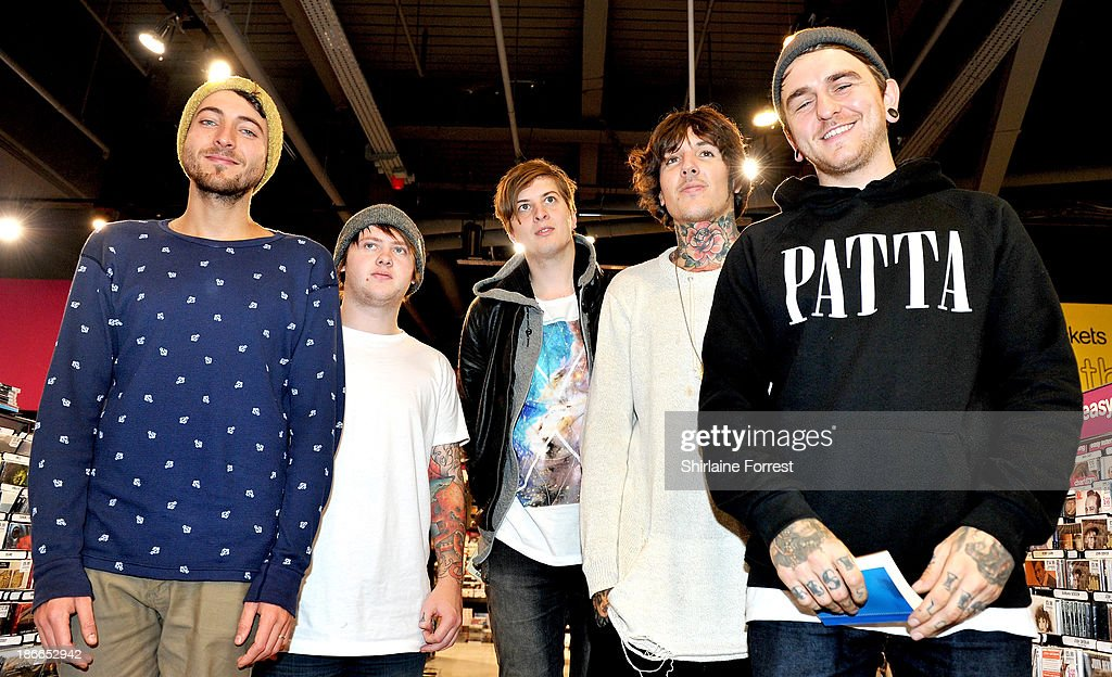 Oliver Sykes, Lee Malia, Matt Kean, Matt Nicholls and Jordan Fish of Bring Me The Horizon pose before meeting fans and signing copies of a new HMV Exclusive T-Shirt at HMV Birmingham Bullring on November 2, 2013 in Birmingham, England.