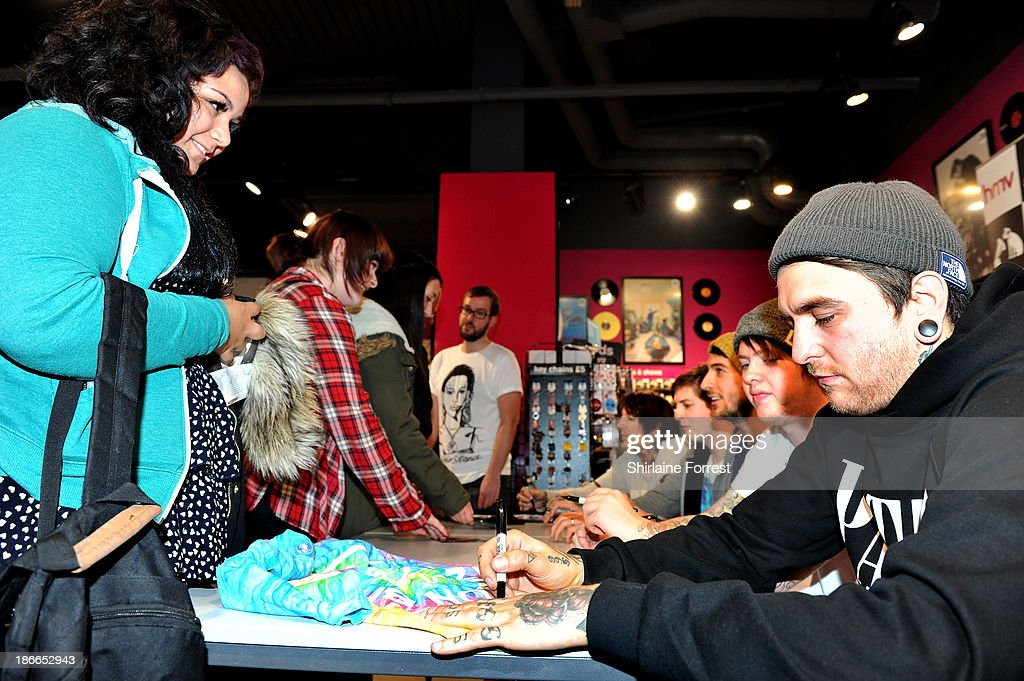 Oliver Sykes, Lee Malia, Matt Kean, Matt Nicholls and Jordan Fish of Bring Me The Horizon meet fans and sign copies of a new HMV Exclusive T-Shirt at HMV Birmingham Bullring on November 2, 2013 in Birmingham, England.