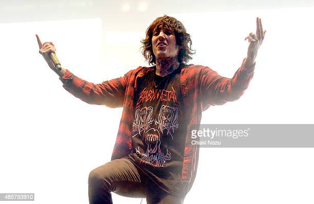 Oliver Sykes of Bring Me The Horizon performs on day 2 of the Reading Festival at Richfield Avenue on August 29 2015 in Reading England