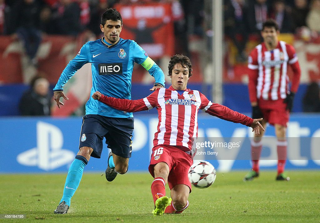 Oliver Torres of Atletico and Lucho Gonzalez of Porto in action during the UEFA Champions League match between Atletico de Madrid and FC Porto at the...