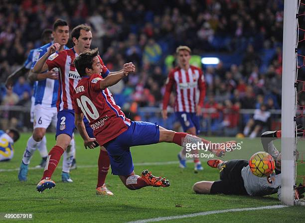Oliver Torres of Club Atletico de Madrid tries to shoot past Pau Lopez of Real CD Espanyol during the La Liga match between Club Atletico de Madrid...