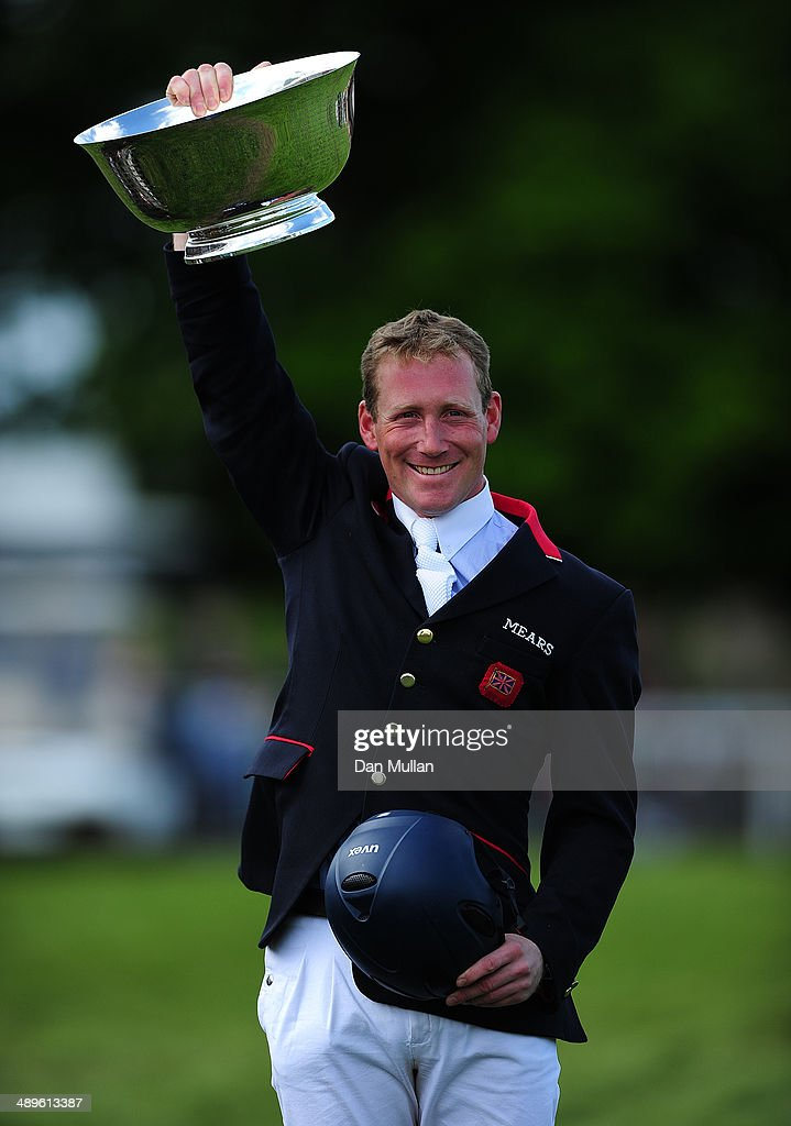 <a gi-track='captionPersonalityLinkClicked' href=/galleries/search?phrase=Oliver+Townend&family=editorial&specificpeople=647073 ng-click='$event.stopPropagation()'>Oliver Townend</a> celebrates with the Butler Bowl for Best British Riding on day five of the Badminton Horse Trials on May 11, 2014 in Badminton, England.