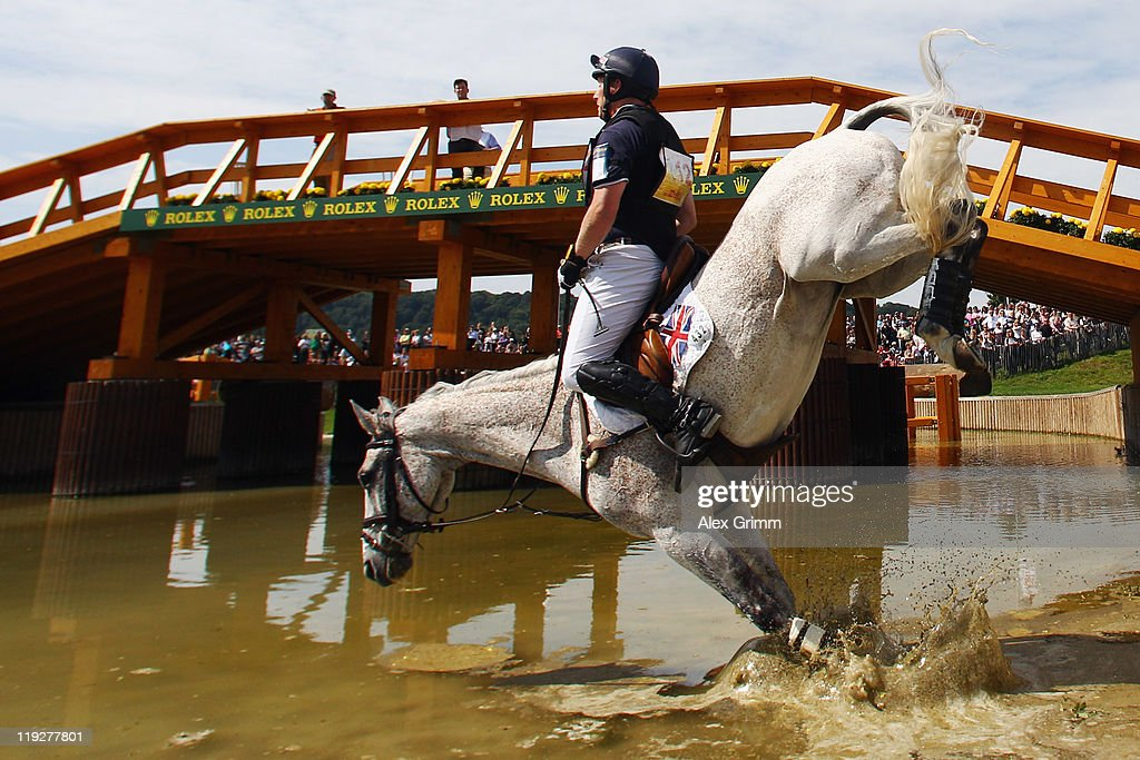 <a gi-track='captionPersonalityLinkClicked' href=/galleries/search?phrase=Oliver+Townend&family=editorial&specificpeople=647073 ng-click='$event.stopPropagation()'>Oliver Townend</a> of Great Britain and his horse Neo du Breuil fall at the water obstacle during the eventing competition at the CHIO on July 16, 2011 in Aachen, Germany.