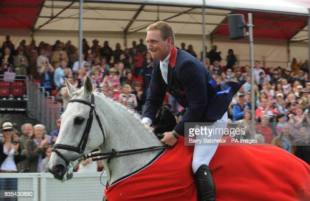 Oliver Townend rides Flint Curtis on a lap of honour after winning the Mitsubishi Motors Badminton Horse Trials