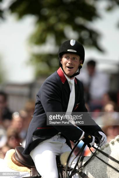 Oliver Townend riding Flint Curtis reacts after realising his overall victory during the show jumping competition on the final day at the Badminton...