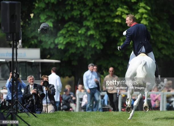 Oliver Townend tosses his helmet into the crowd after winning Mitsubishi Motors Badminton Horse Trials on Flint Curtis