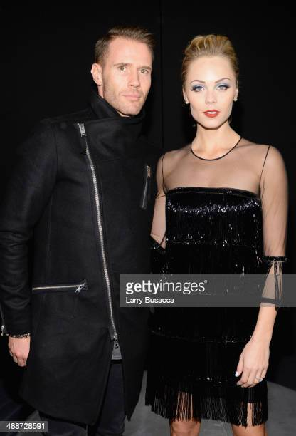 Oliver Trevenna and Laura Vandervoort attend the Naeem Khan fashion show during MercedesBenz Fashion Week Fall 2014 at The Theatre at Lincoln Center...