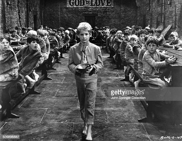 Oliver Twist boldly walks to the front of the orphanage dining hall to ask for more porridge in the 1968 musical film Oliver based on the novel...