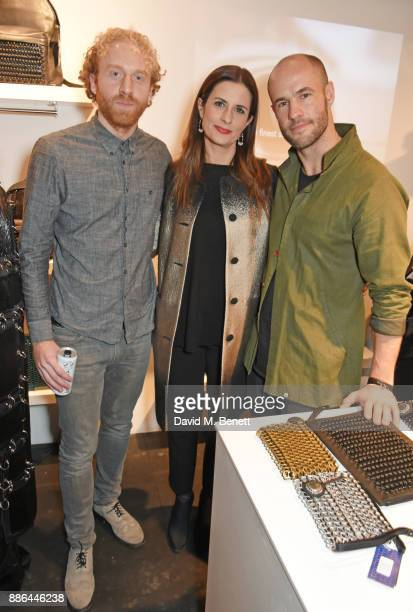 Oliver Wayman Livia Firth and Cameron Saul attend the opening of the BOTTLETOP flagship store on Regent Street on December 5 2017 in London England