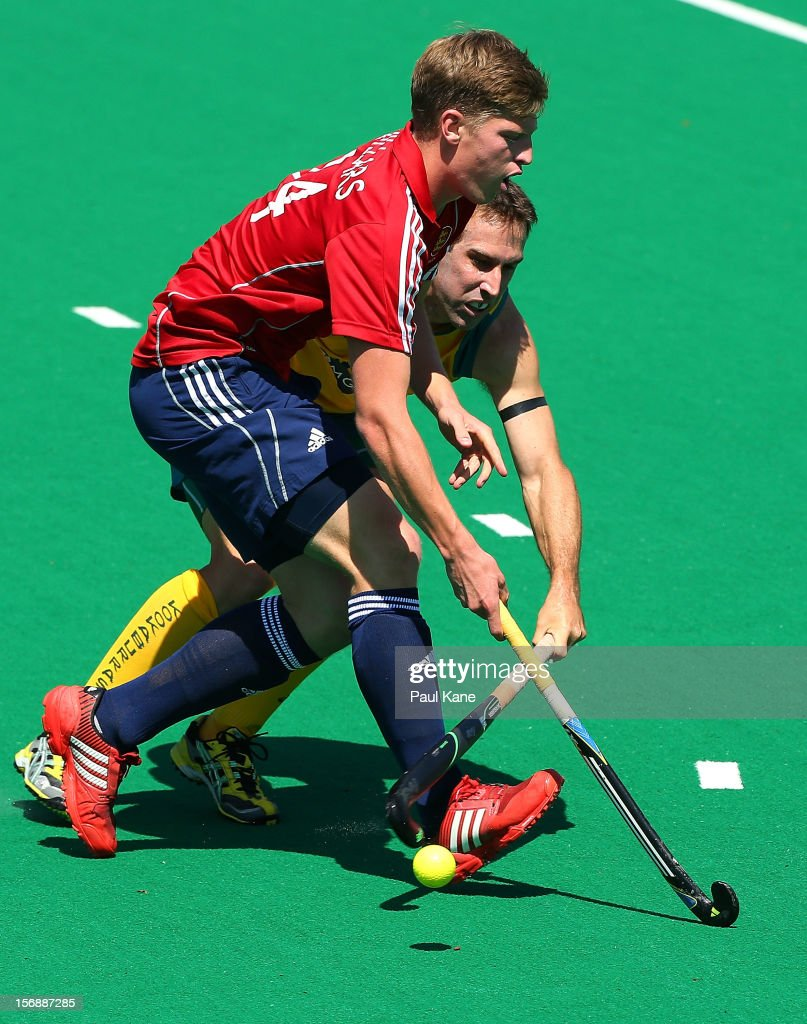 Oliver Willars of England and Liam De Young of the Kookaburras contest for the ball in the mens Australia Kookaburras v England game during day three of the 2012 International Super Series at Perth Hockey Stadium on November 24, 2012 in Perth, Australia.