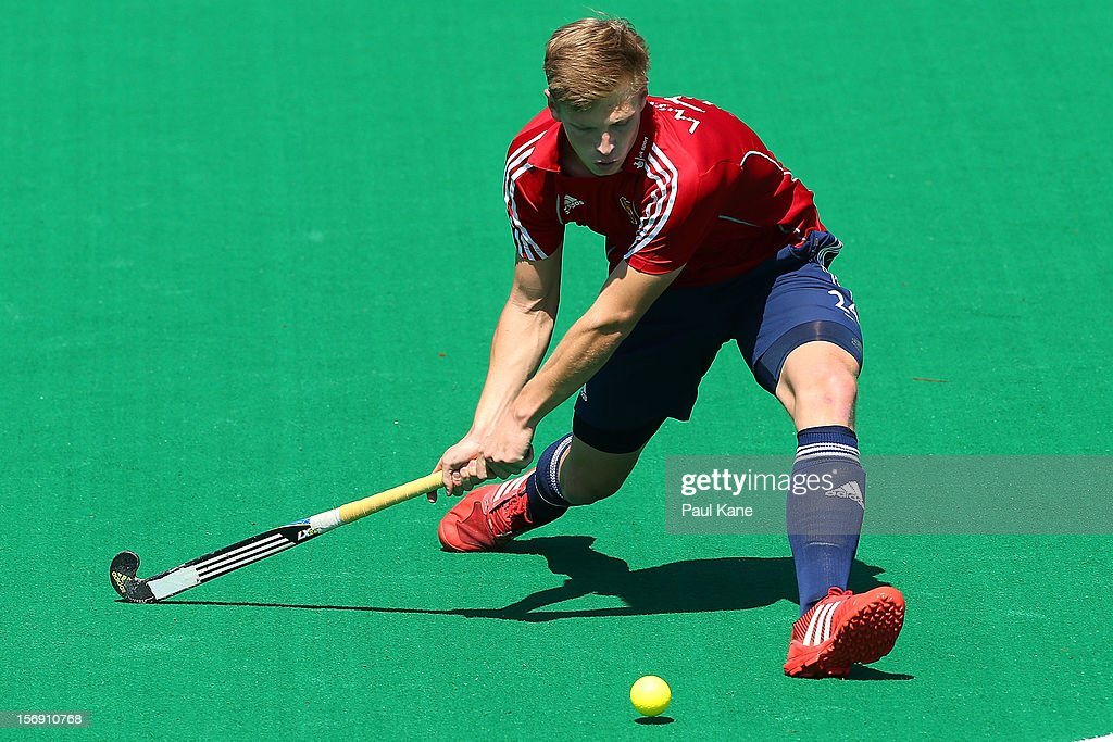 Oliver Willars of England passes the ball in the mens Australia Kookaburras v England game during day three of the 2012 International Super Series at Perth Hockey Stadium on November 24, 2012 in Perth, Australia.