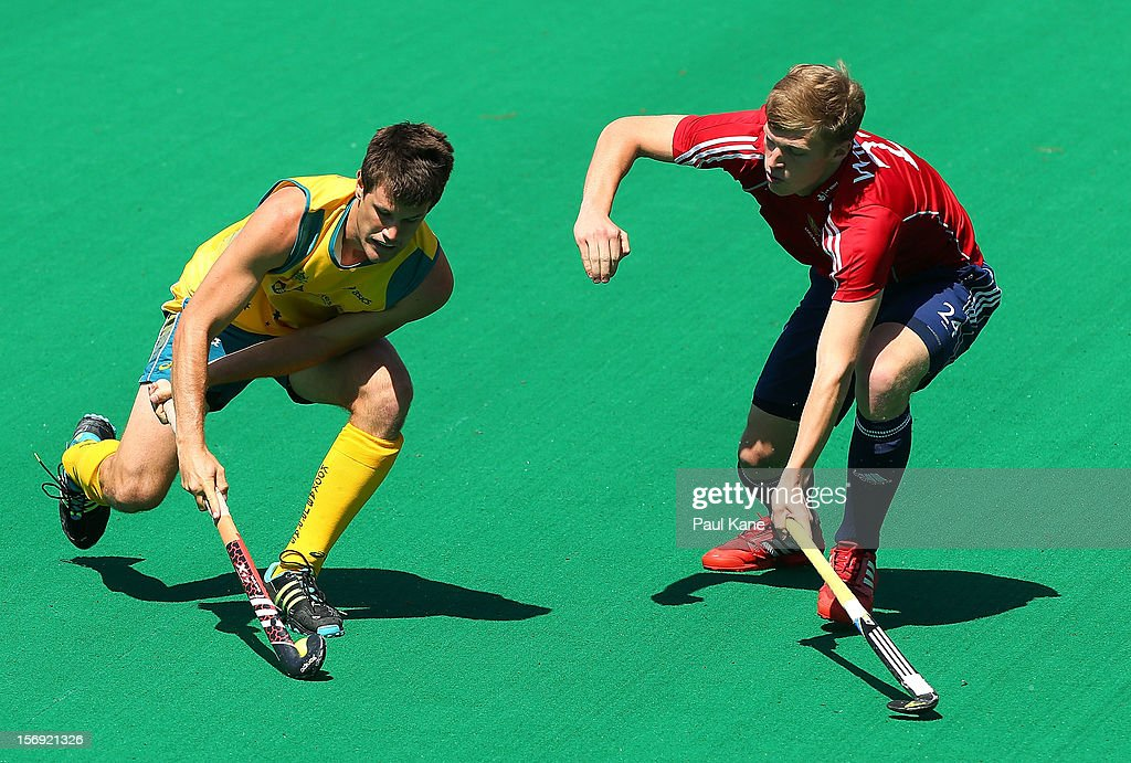 Oliver Willars of England tackles Matthew Gohdes of the Kookaburras in the gold medal match between the Australian Kookaburras and England during day four of the 2012 International Super Series at Perth Hockey Stadium on November 25, 2012 in Perth, Australia.