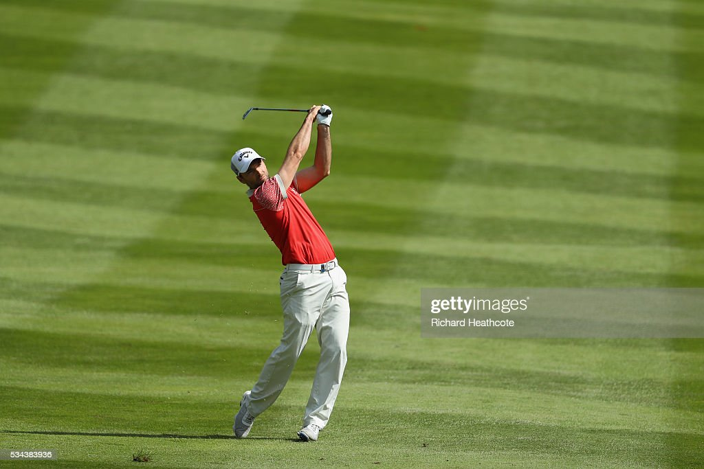 <a gi-track='captionPersonalityLinkClicked' href=/galleries/search?phrase=Oliver+Wilson&family=editorial&specificpeople=196534 ng-click='$event.stopPropagation()'>Oliver Wilson</a> of England hits his 2nd shot on the 4th hole during day one of the BMW PGA Championship at Wentworth on May 26, 2016 in Virginia Water, England.
