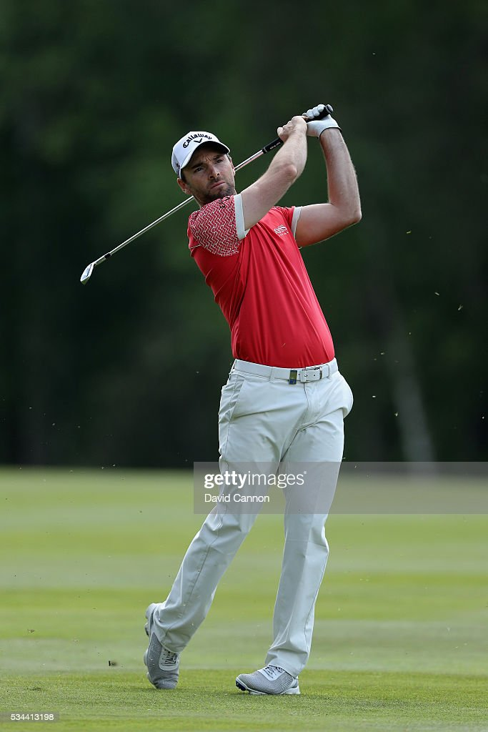 <a gi-track='captionPersonalityLinkClicked' href=/galleries/search?phrase=Oliver+Wilson&family=editorial&specificpeople=196534 ng-click='$event.stopPropagation()'>Oliver Wilson</a> of England hits his 2nd shot on the 9th hole during day one of the BMW PGA Championship at Wentworth on May 26, 2016 in Virginia Water, England.