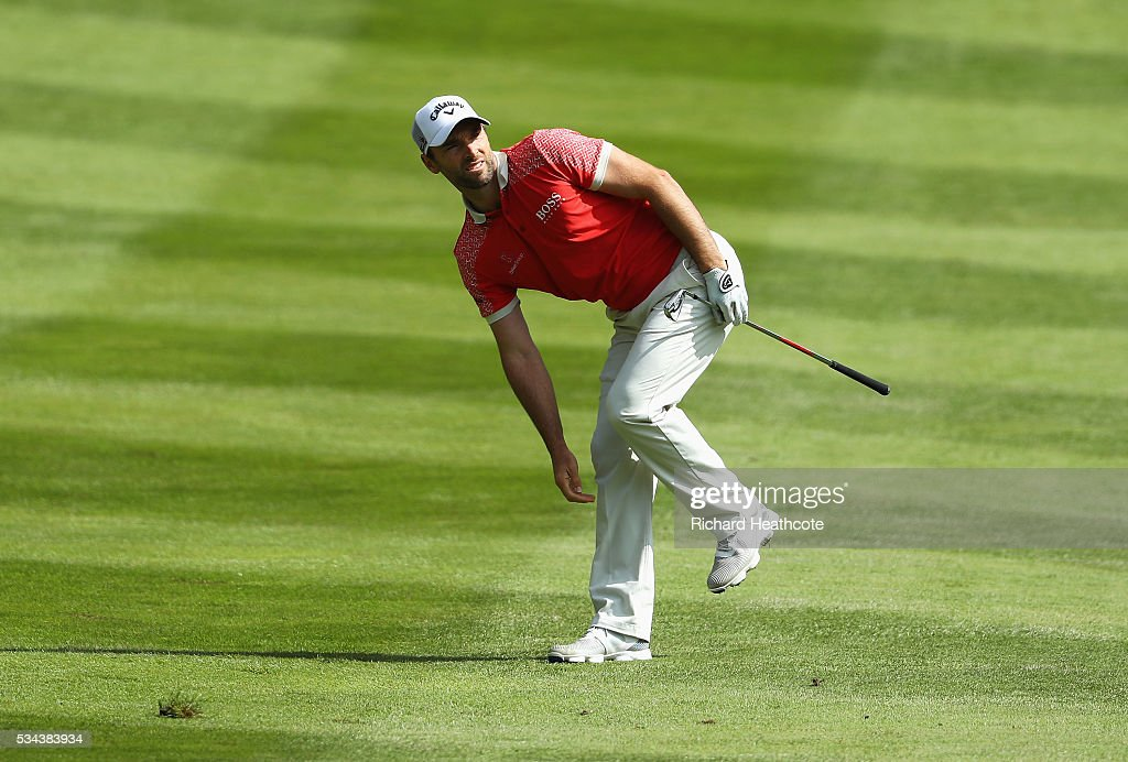 <a gi-track='captionPersonalityLinkClicked' href=/galleries/search?phrase=Oliver+Wilson&family=editorial&specificpeople=196534 ng-click='$event.stopPropagation()'>Oliver Wilson</a> of England watches his 2nd shot on the 4th hole during day one of the BMW PGA Championship at Wentworth on May 26, 2016 in Virginia Water, England.