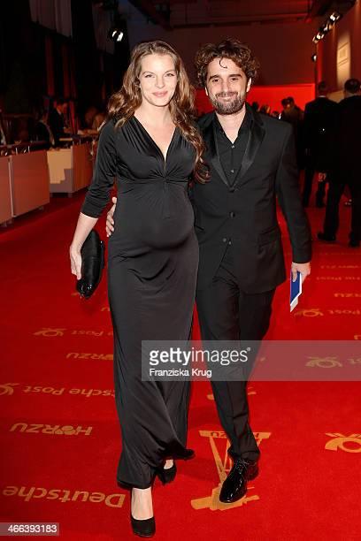 Oliver Wnuk and Yvonne Catterfeld attend the Goldene Kamera 2014 at Tempelhof Airport on February 01 2014 in Berlin Germany