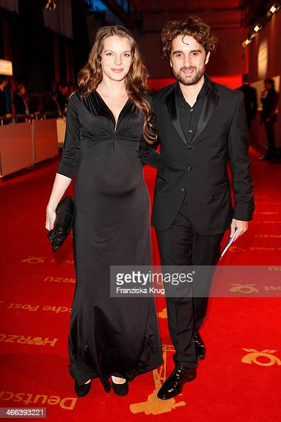Oliver Wnuk and Yvonne Catterfeld attend the Goldene Kamera 2014 at Tempelhof Airport on February 01 2014 in Berlin Germany