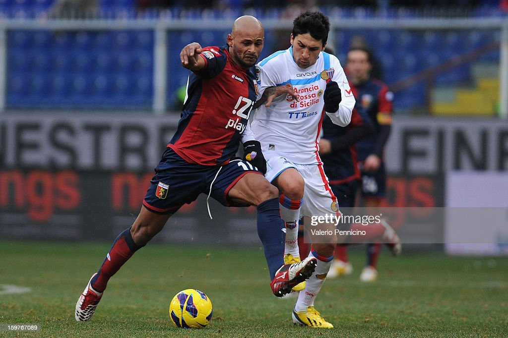 Olivera (L) of Genoa CFC competes with Pablo Cesar Barrientos of Calcio Catania during the Serie A match between Genoa CFC and Calcio Catania at Stadio Luigi Ferraris on January 20, 2013 in Genoa, Italy.