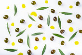 olives, leaves and  oil drops isolated on a white background