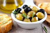 close up of olives with garlic,rosemary and crostini