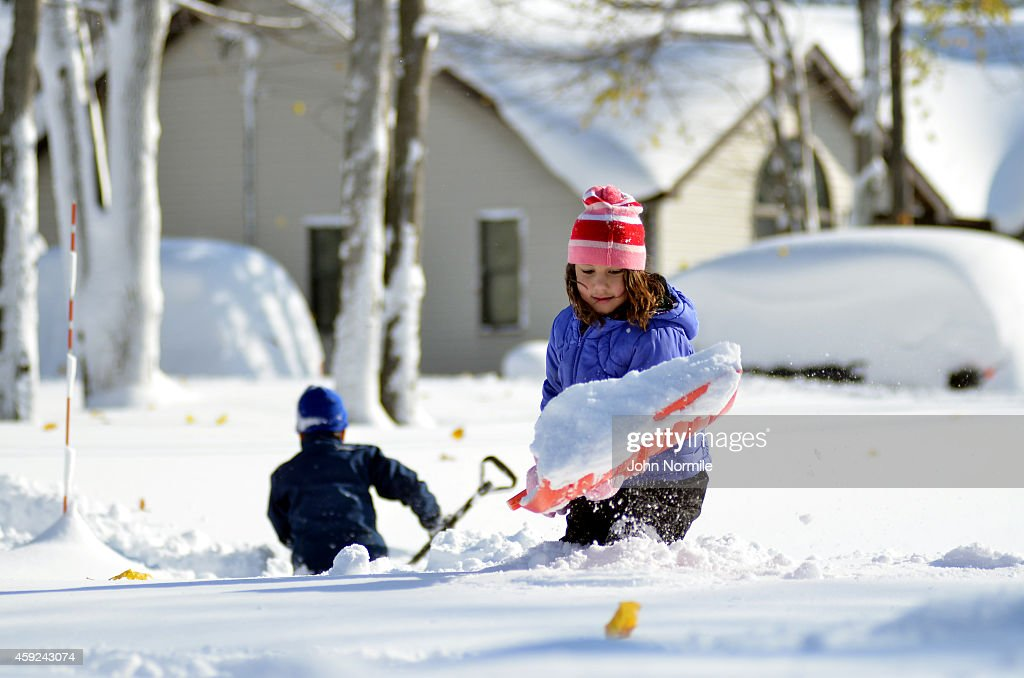 Olivia Ahmed makes her way through nearly five feet of snow on November 19 2014 in the Lakeview neighborhood of Buffalo New York The record setting...