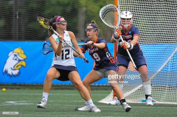 Olivia Cleave of College of New Jersey is defended by Rebeka Riley of Gettysburg College during the Division III Women's Lacrosse Championship held...