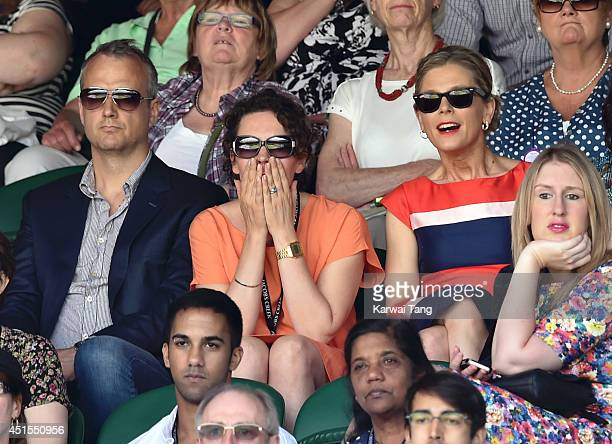 Olivia Colman and Emilia Fox attend the Angelique Kerber v Maria Sharapova match on centre court during day eight of the Wimbledon Championships at...