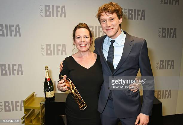 Olivia Colman winner of the Best Supporting Actress award for 'The Lobster' and presenter George MacKay pose at the Moet British Independent Film...