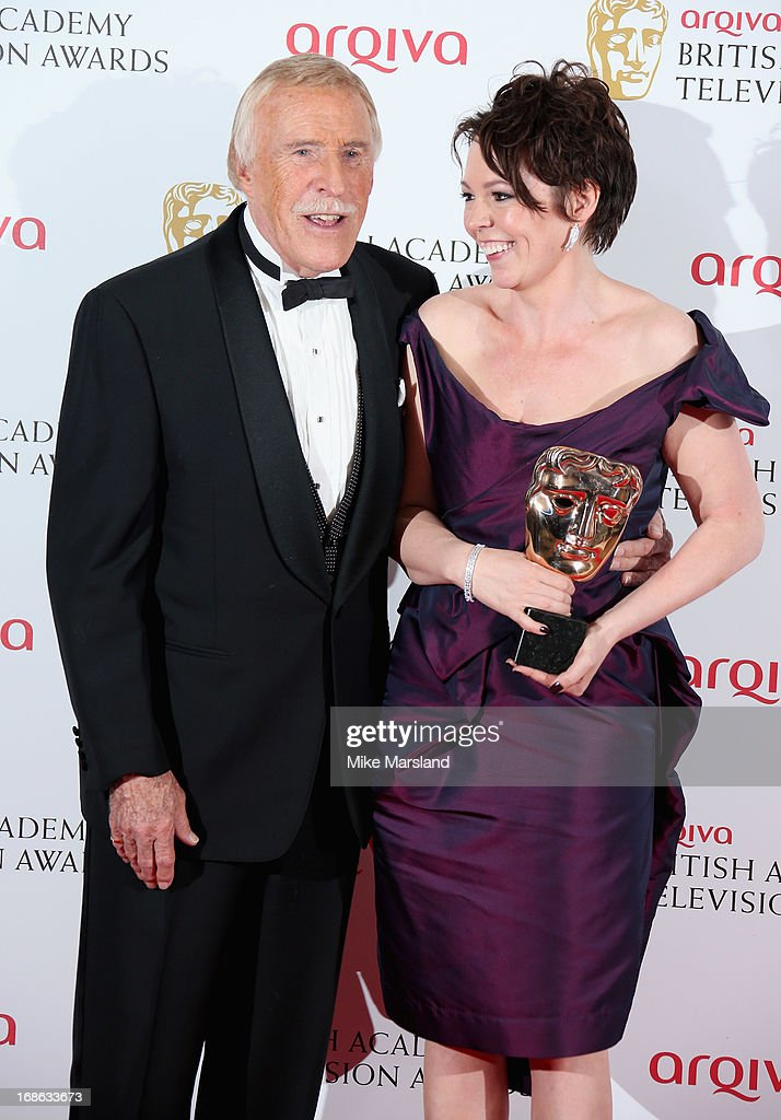 Olivia Colman with her Best Female in a Comedy and Best Supporting Actress awards with presenter Bruce Forsyth during the Arqiva British Academy Television Awards 2013 at the Royal Festival Hall on May 12, 2013 in London, England.